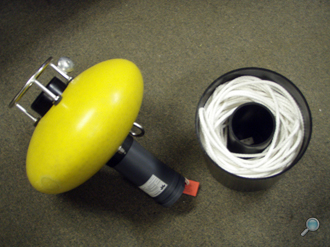 Ellipsoid-shaped pop-up buoy